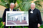 Dave and Ed McDonald with design for McDonald Family Plaza