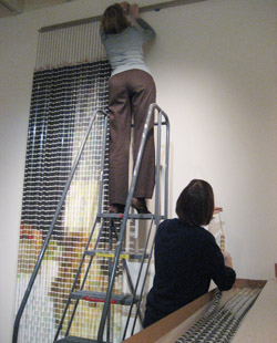 curators installing devorah sperber work