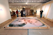 art installers at work on Paint Made Flesh