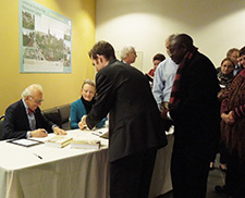 Dr. Eric Kandel signs copies of The Age of Insight