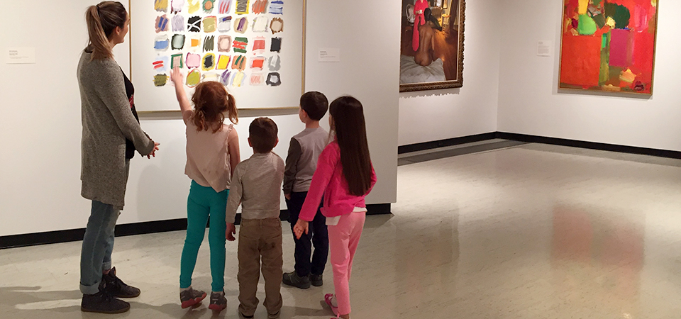 Casey with kids looking at ART